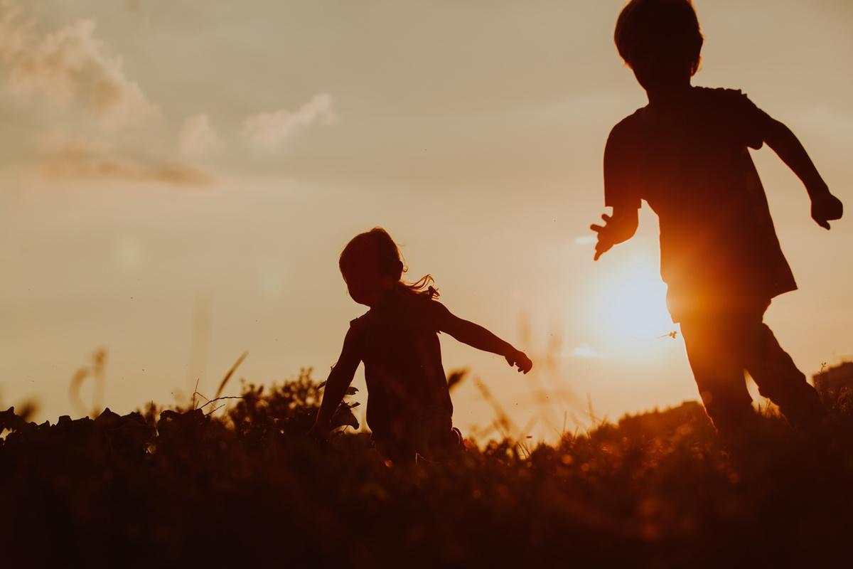AdobeStock_Boy_and_Girl_Running_Silhouette_Sunset-1200.jpeg