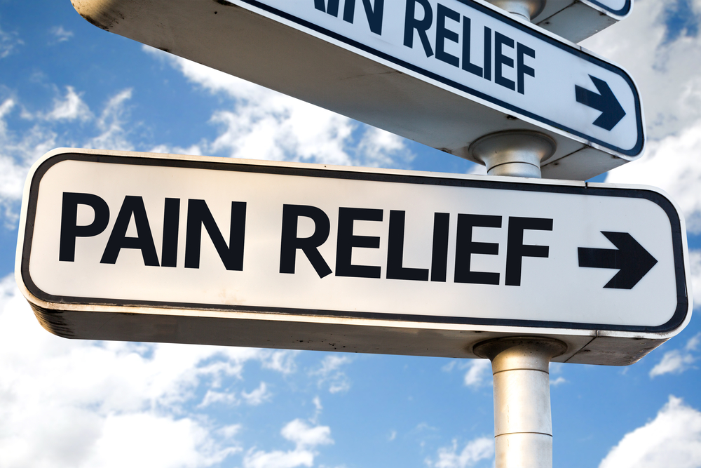 Pain Relief direction sign on sky background-1